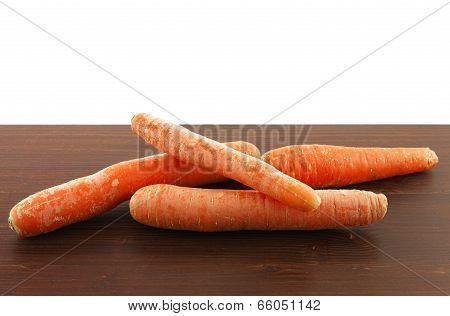 Carrots On Wooden Board