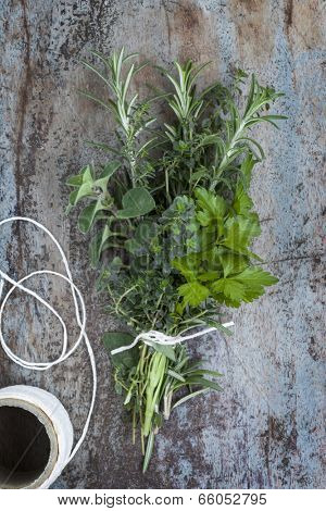 Bouquet garni of fresh herbs, tied with twine.  Rosemary, thyme, oregano, parsley.