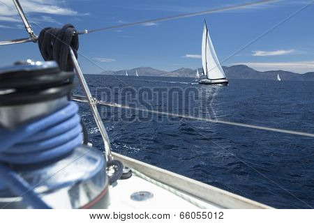 Winch with rope on sailing boat in the sea.