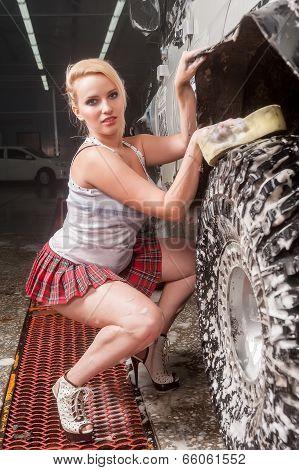 Attractive sexy woman washing car