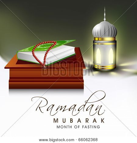 Religious holy book of Islamic religion Quran Shareef and praying mantis with arabic lantern for celebration of holy month Ramadan Mubarak.