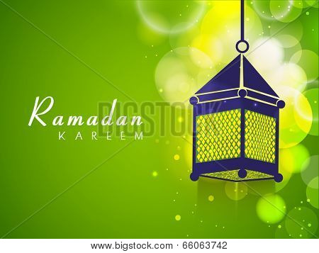 Hanging arabic lantern on shiny green background for celebration for holy month of Muslim community Ramadan Kareem.