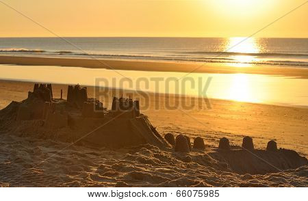 Big sand castle on the beach at evening