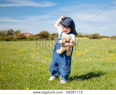 A Baby Girl Walking In The Field