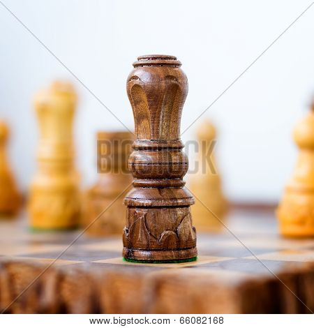 Conceptual Photo Of Chess King Standing Before The Set Of Another Colour Pieces