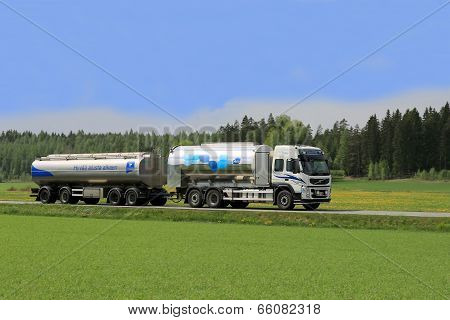 Milk Tanker Truck On Scenic Summer Road