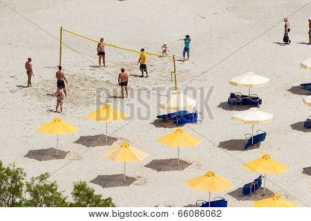 People Playing Beach Volley At The Beach Of Kallithea, One Of The Most Visited Destinations In Greec