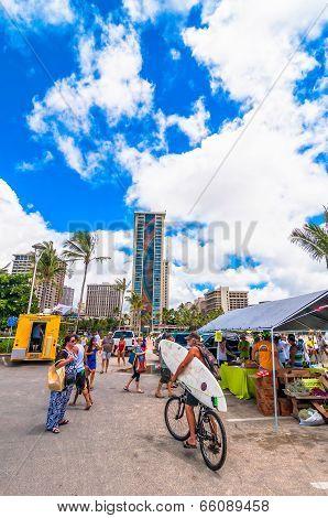 tourists and locals in Waikiki market - Honolulu