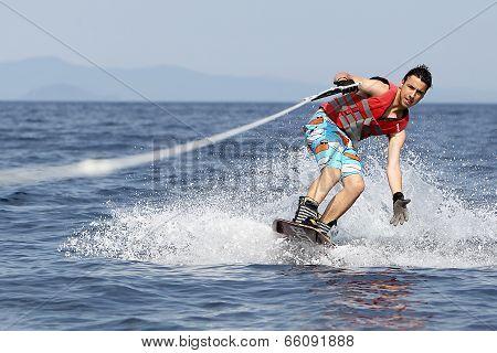Unidentified Man Doing Water Ski On The Sea In Kallithea, Greece.