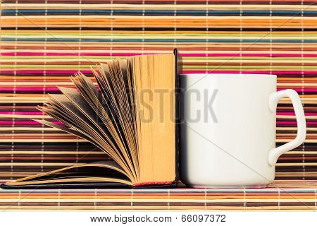 The Opened Book And Cup