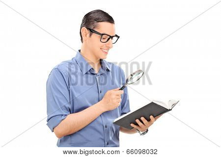 Guy reading a book through a scrutiny isolated on white background
