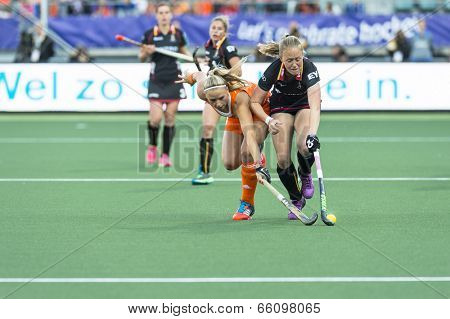THE HAGUE, NETHERLANDS - JUNE 2: Jacky Schoenmaker (Netherlands, left), challenges Jill Boon (Belgium) for the ball, during the match between NED and BEL (4-0) at the Rabobank World Cup Hockey