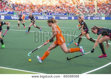 THE HAGUE, NETHERLANDS - JUNE 2: Dutch Hoog is controling the ball with her stick, Belgium player de Groof is trying to take over the ball during the Hockey World Cup 2014 NED beats BEL 4-0