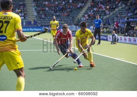 THE HAGUE, NETHERLANDS - JUNE 2: Englishman Martin is trying to block Indian player Kangujam during the Hockey World Cup 2014 in the match between England and India (men). GBR beats IND 2-1