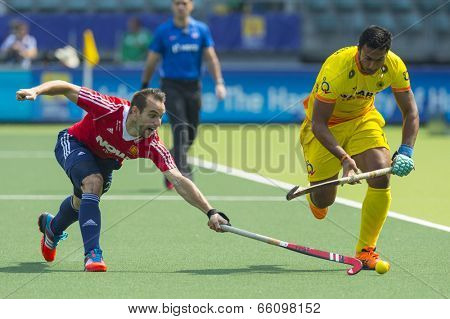 THE HAGUE, NETHERLANDS - JUNE 2: Englishman Catlin reaches for the ball to stop a rush by Indian player Raghunath  during the Hockey World Cup 2014 GBR beats IND 2-1