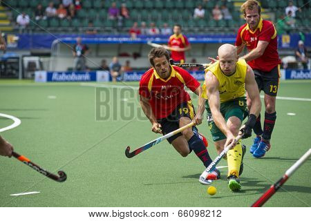 THE HAGUE, NETHERLANDS - JUNE 2: Australian Hammond is playing the bal while Spanish player Salles is right behind him during the Hockey World Cup 2014. AUS beats SPA 3-0