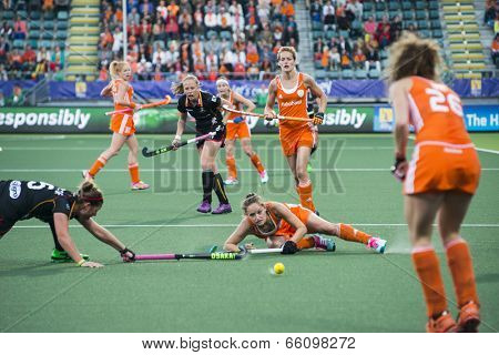 THE HAGUE, NETHERLANDS - JUNE 2: Dutch Jonker is sliding to win the battle for the ball with Belgium player De Groof during the Hockey World Cup 2014 NED beats BEL 4-0