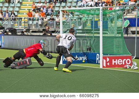 THE HAGUE, NETHERLANDS - JUNE 1: German field hockey player Wesley races in for the rebound on Straikowski's second goal against South Africa. Goalie Robinson (RSA) is too late
