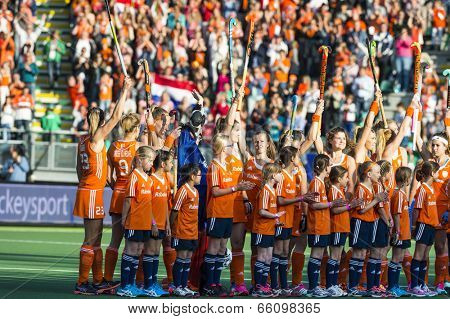 THE HAGUE, NETHERLANDS - JUNE 2 2014: The Dutch women field hockey team cheers back at the fans at the line up for the match against Belgium at the Rabobank World Cup Hockey. NED beats BEL 4-0