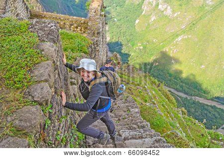 Young tourist climbing Huayna Picchu (Machu Picchu, Peru)
