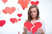 picture of broken hearted  - Young girl holding a broken heart - JPG
