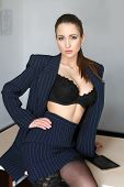foto of provocative  - Sexy young provocative teacher in underwear sitting on desk - JPG