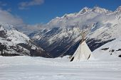 picture of teepee  - Indian style teepee tent set high up in the Swiss Alps - JPG
