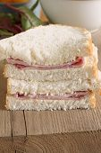pic of home-made bread  - Rustic style hand cut ham sandwich made with home made bread - JPG