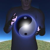 stock photo of yin  - Man with Yin Yang Sphere - JPG