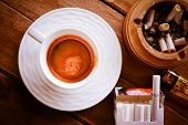 pic of cigarette lighter  - coffee cup and cigarette in ashtray on wood table - JPG