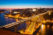stock photo of dom  - Dom Luiz bridge in Porto Portugal at dusk - JPG