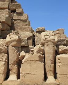 pic of beheaded  - beheaded statues of Karnak Temple ancient ruins - JPG