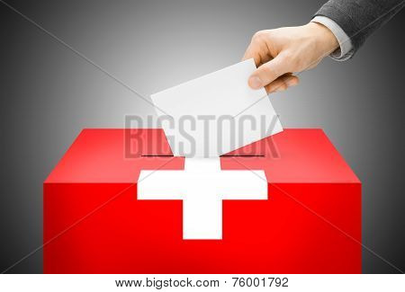 Voting Concept - Ballot Box Painted Into National Flag Colors - Switzerland