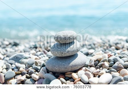 three stones on stack near sea. zen like concept