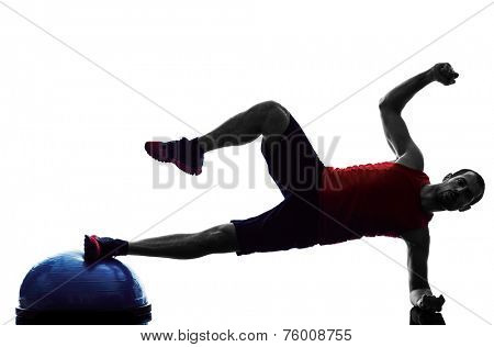 one man exercising fitness balance trainer  in silhouette isolated on white background