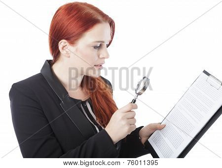 Young Woman Reading Document With Magnifying Glass
