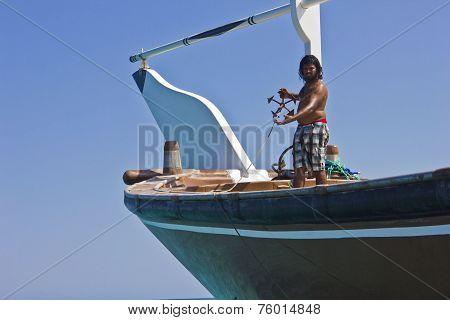 Omani Fishermen On Its Boat