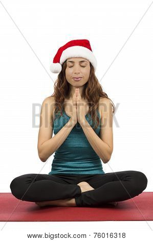 Christmas Woman With Santa Hat In Meditation