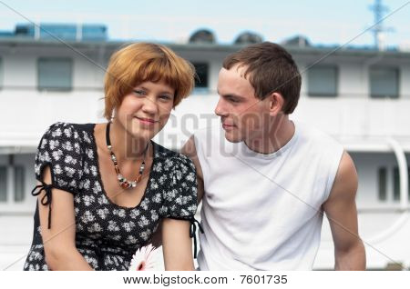 Young Loving Couple Teens Sitting together.