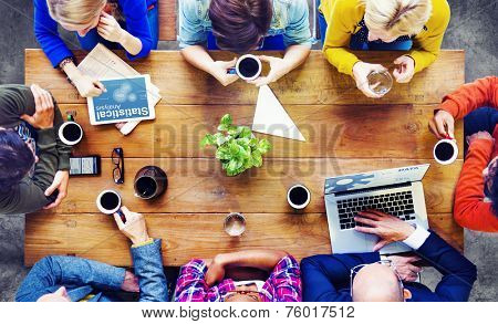 Group of Business People Discussing on a Cafe