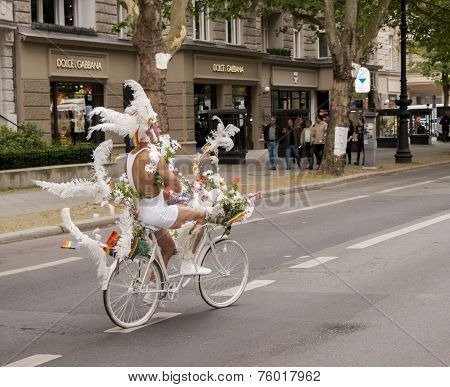 Elaborately Dressed Participant Riding Bike, During Christopher Street Day Parade