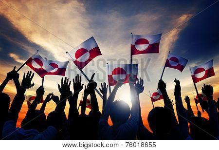 Silhouettes of People Holding Flag of Greenland