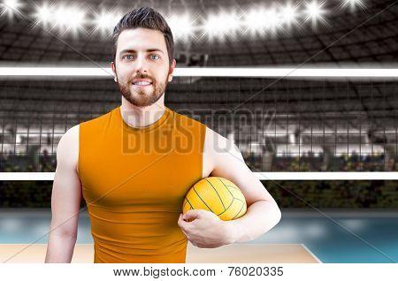 Volleyball player on orange uniform on volleyball court.