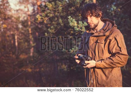 Young Man with retro photo camera outdoor Travel Lifestyle