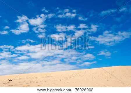 Desert Dune And Cloudy Sky