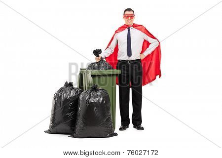 Superhero standing by a trash can isolated on white background