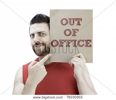 Man holding a card with the text Out Of Office on white background