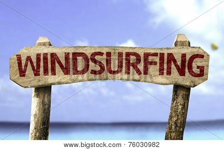 Windsurfing sign with a beach on background