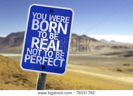 You Were Born To Be Real Not To Be Perfect sign with a desert background