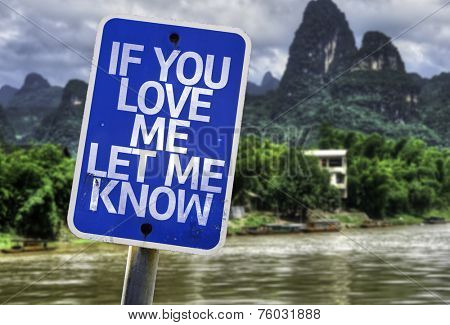 If You Love Me Let me Know sign with a forest background